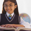 Young Hispanic girl at desk in classroom  — Stock Photo