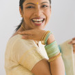 Stock Photo: Indian woman in traditional clothing smiling