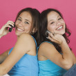 Two young women talking on cell phones — Stock Photo #13238741