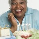 Senior woman celebrating her birthday — Stock Photo