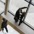 Businesspeople talking in lobby area — Stock Photo
