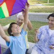 Family flying kite — Stock Photo