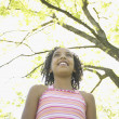 Low angle view of African girl outdoors — Stock Photo