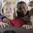 Portrait of children on school bus — Stock Photo