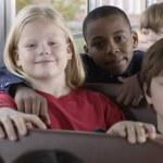 Portrait of children on school bus — Stock Photo
