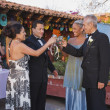 Hispanic couples toasting at Quinceanera — 图库照片