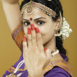 Indian woman dancing in traditional dress — Stock Photo