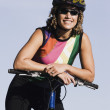 Female cyclist smiling for the camera - Stock Photo