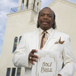 Senior African American man in front of church — Stock fotografie