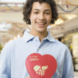 Multi-ethnic teenage boy holding Valentine's Day heart — Stok fotoğraf