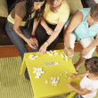 Female members of a family playing dominoes — Stock Photo