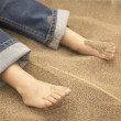 Toddler's feet in sand — Stock Photo