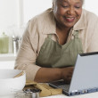 Senior woman using a laptop — Stock Photo