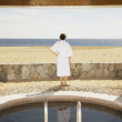 Woman in bathrobe outdoors at beach resort  — Stock Photo