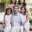 Stock Photo: Senior couple and their granddaughters smiling for the camera