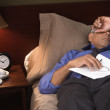Businessman asleep in his hotel room — 图库照片
