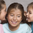 Three girls whispering - Stock Photo