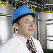 Stock Photo: Portrait of mwearing hardhat and lab coat