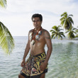 Pacific Islander man in traditional dress on beach — Stock Photo