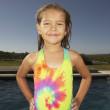 Young girl wearing tie-dye swimsuit — Stock Photo #13239273