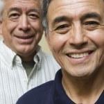 Close up portrait of two elderly men — Stock Photo