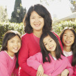 Stock Photo: Asimother with three young daughters smiling outdoors