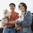 Couple holding their dogs — Stock Photo