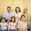 Stock Photo: Hispanic family at birthday party