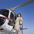 Asian businesswoman on helicopter — Foto Stock