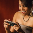 Africwomplaying hand held video game — Stock Photo #13239559