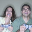 Man and woman playing video games — Foto de Stock