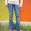 Stock Photo: Womwearing jeans and pumps