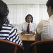 Indian businessman talking to clients — Stock Photo