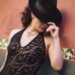 Hispanic woman wearing fedora hat — Stock Photo #13239624