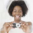 Stock Photo: Africbride taking photograph