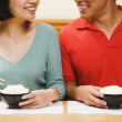 Stock Photo: Asian couple eating rice