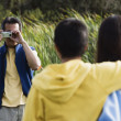 Man taking picture of his family — Stock Photo
