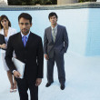 South American businesspeople in empty swimming pool — Stockfoto