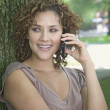 Hispanic woman talking on cell phone outdoors — Stock Photo
