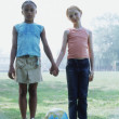 Full view portrait of two girls holding hands — Stock Photo