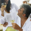 South American couple drinking wine — Stock Photo