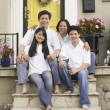 Stock Photo: Portrait of Asifamily on porch