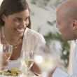 Stock Photo: Couple eating dinner. Young couple talking to each other eating food