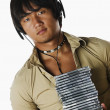 Young man listening to music with stack of compact discs — Stock Photo #13239808