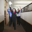 Businesspeople cheering in office — Stock Photo