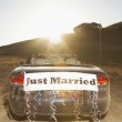 Convertible with Just Married sign on the back — Stock Photo #13239888