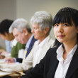Asian businesswoman at meeting — Stock Photo
