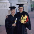 Graduates smiling together — Stock Photo