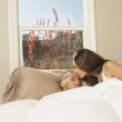 Stock Photo: Hispanic couple in bed