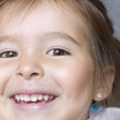 Stock Photo: Close up portrait of young girl smiling